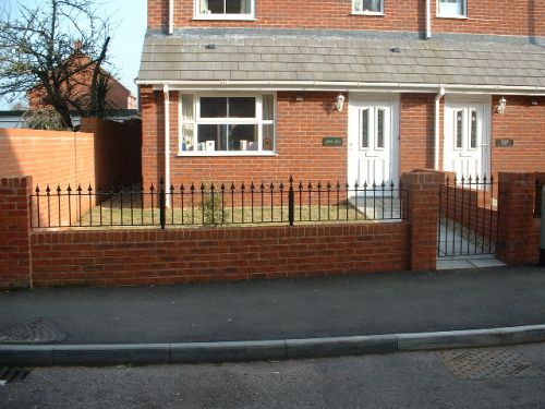 Stylish gate and railings, fabricated in mild steel,  installed at Jubilee Gardens in Cullompton.