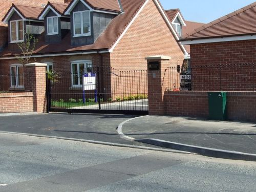 Fabricated steel sliding gate and railings, galvanised and powder coated finish, installed in Exmouth.