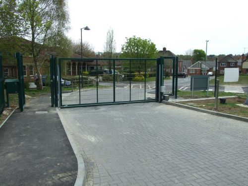 Fabricated steel sliding gate, galvanised and powder coated, installed at a school to provide controlled access.