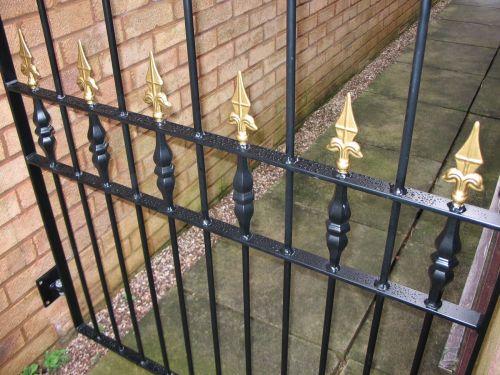 Bespoke fabricated mild steel garden gate, unique and stylish design, powder coated.
