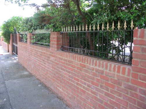 These railings with the gold coloured rail heads add style and a great finish to the look of the property.
