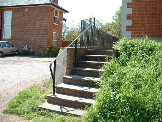 Bespoke fabricated mild steel staircase handrail installed for safety, Exeter, Devon
