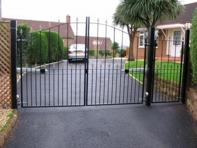 Arched drive and pedestrian gates, fabricated in mild steel.