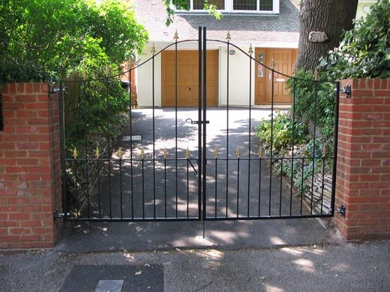 Arched drive gates fabricated in mild steel, Bournemouth.